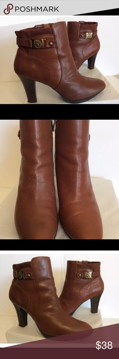 """Ann Klein Brown Leather Ankle Boots Ann Klein Asher Ankle Boot Color- Brown Size- 10M Comfortable and versatile brown ankle boot, side zipper closure, back of ankle area its made of elastic fabric for comfort, approx. 4"""" heel.  In great shape, minor staining to leather, small possible water spot on the left boot not very noticeable please look at all pictures, very clean interior. Ann Klein Shoes Ankle Boots & Booties"""