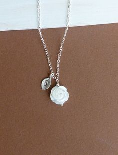 White Carved Mother of Pearl Rose Necklace with Hand Stamped Initial Leaf on Sterling Silver Chain. $23.50, via Etsy.