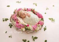 Flower wreath. Newborn baby girl in flowers. Sunny newborn photo ideas.