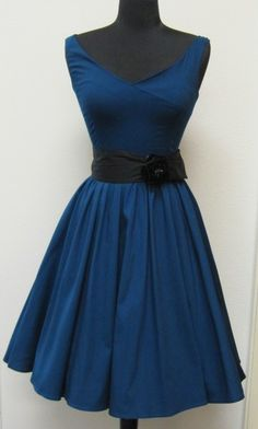 now, this would be a cute choir dress. not those black funeral dresses we got. Bleh.