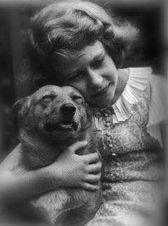 Young (future Queen) Elizabeth with Corgi