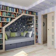 Reading Spot At Home Below The Book Collection...this looks like a comfy reading space