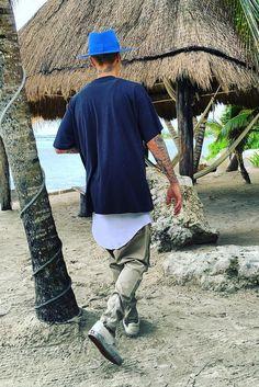 Justin Bieber wearing Vans Vault Classic Slip On LX, LIU NYC Khaki Cargo Pants, Maison Michel Classic Fedora Hat