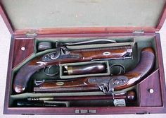 """A Fantastic Near Mint Cased Set of English Percussion Sea Captain's Pistols, circa. 1840. Made by 'WILLIAMS & Co."""", """"LONDON"""". 7"""", .66 cal. smooth-bore octagon steel barrels with beautiful original rin"""