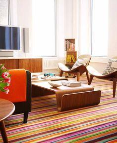 striped area rug in an interesting living room photographer : Hallie Burton