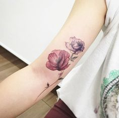Poppy and rose tattoo by Tattooist Flower