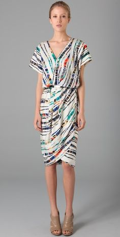rachel roy. tulip dress. $416. I would never buy a dress that expensive, but WOW it's pretty.
