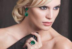 Emerald Ring & Earrings Cushion cut Columbian Emerald Ring 14.37 Cts. with 1.48 Cts. half moon shape Diamond Shoulders Pear shape Columbian Emerald Earrings 27.56 Cts.