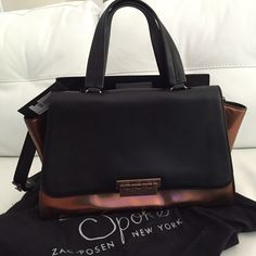 Zac Posen Eartha Soft Satchel East/West NWT NWT - Zac Posen Eartha Soft East/West leather satchel in black and bronze. Beautifully structured, optional shoulder strap, double handles, and bronze hardware. Brand new, never used. Zac Posen Bags Satchels