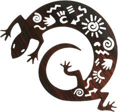 """Lizard Product Description Enhance the design and usefulness within your living room, home or office with rustic metal 12"""" Lizard Designed with Indian Symbols, Lizard Metal Wall Art piece. This beautiful piece is a lizard with intricate designs in its body, wrapped in a coil. This wall art is"""