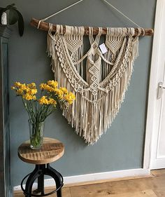 HANDMADE MACRAME WALL HANGING This wall hanging is handcrafted with freehand patterns so the end result is always unique. A perfect addition to any room. This wall hanging will give your home that extra Bohemian feel. Made with natural cotton cord and knotted around a beautiful piece of wood. You can choose between two branch types : Brich wood or Liana wood. Please note that each branch is unique and wont be the same as in the photo. ▴ D I M E N S I O N S Dimensions for Birch wood…
