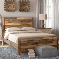 With its distressed look and planked wood, this platform bed has plenty of rustic charm to spare. Made from solid pine, the bed features plenty of natural variation in grain and color as well as distressed embellishments like exposed nail holes. All together, they create a look filled with lived-in character that's right at home in a rustic or farmhouse-inspired space. The platform bed design includes a slat kit, so a separate box spring is not necessary. Simply place your mattress on the… Diy King Bed Frame, Bed Frame Plans, Wooden Bed Frames, Wood Beds, Pallet Wood Bed Frame, Rustic Bed Frames, Pallet Bedframe, Home Bedroom, Bedroom Decor