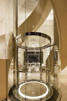 Louis Vuitton Townhouse, Ground floor by CURIOSITY More design with lift Home Stairs Design, Dream Home Design, Modern House Design, Mansion Interior, Luxury Interior, Glass Lift, Glass Elevator, Elevator In House, Flur Design