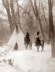 picture of Indians in Winter Camp. The picture was taken in 1908, and shows some Apsaroke Indians.