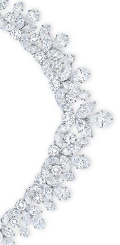 AN IMPORTANT DIAMOND NECKLACE, BY CARTIER. Designed as a line of marquise and brilliant-cut diamonds, the front suspending a series of graduated vari-cut diamond foliate fringes, mounted in platinum, 38.4 cm long. Signed Cartier, No. HSS21.