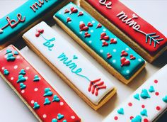 Valentine's cookie sticks ... teal red and white valentine cookies ... be mine arrows     Www.facebook.com/tinykitchencakery