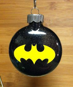 Batman logo glitter ornament with a curly hook to hang from the tree. Any superhero available if Batman is not who you are looking for    2 5/8