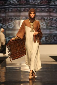 Islamic Inspired Fashion As Seen in Indonesia Fashion Week 2012   For today's post, we look at some of the Islamic inspired modern fashion c...