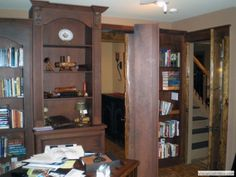 Hidden door bookcase in office