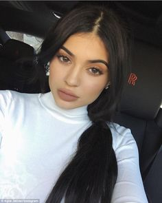Looking glam:As usual, the youngest of the Kardashian's was sporting a full face of make-up