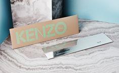 時裝週邀請函 - Kenzo 一張前往宇宙的單程票,鏡面設計的邀請函充滿了未來感