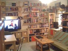 https://flic.kr/p/7B9Lur | studio-apartment | This is my studio apartment, facing in from the foyer.  Bookshelves & bar-height table on the left, an assortment of IKEA bookshelves (Expedit, ARTISTE, can't think what the other one is), then my coffee table, sofa, and another bookshelf.