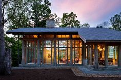 Love the use of timbers as posts- Wow, it's like a glass cabin!!