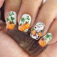just_alexiz - Snoopy in a pumpkin patch.