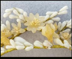 Antique wax orange blossom wedding crown, or tiaras for bride dolls. Double row; each approximately 15 inches long. There should be enough to make