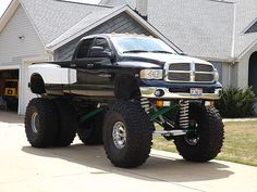 This nearly 11′ tall 2003 Dodge Ram dually sports an astounding six 54″ Mickey Thompson Baja Claw tires and a pretty unbelievable 28″ of lift to make it all happen.