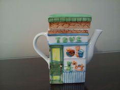 """Tea Pot w/Store Front Building Theme In Pastel Colors 7.5"""" x 6.5"""" priced to sale"""