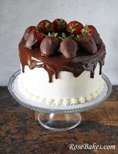 Chocolate Cake with Vanilla Frosting Topped with Ganache and Chocolate Dipped Strawberries by @RoseBakes