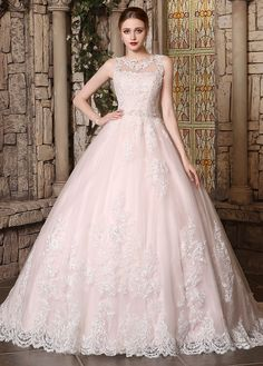 Romantic tulle jewel neckline ball gown wedding dress with beaded lace appliques. Ethereal and charming, this luxurious bridal gown is a classy choice for your special day.