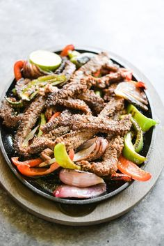These beef fajitas get a marinade in lime juice and coconut aminos, resulting in tender, flavorful beef that is seared to perfection and served alongside grilled bell peppers, onions, and all of the fixings! Beef Fajita Marinade, Beef Fajita Recipe, Beef Fajitas, Healthy Living Recipes, Best Low Carb Recipes, Free Recipes, Clean Eating Meal Plan, Clean Eating Recipes, Grilled Bell Peppers