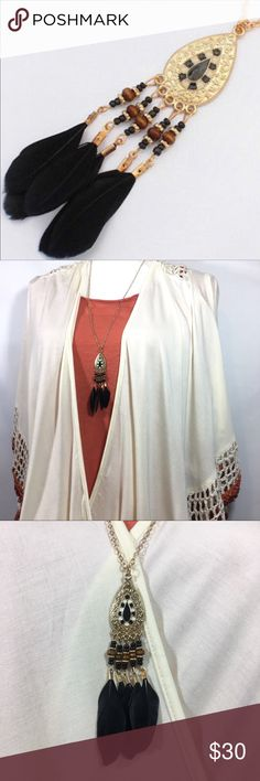 """Boho Festival Feather & Bead Tassel Necklace Boho Festival Feather & Bead Tassel Necklace. 28"""" Long Goldtone chain. Goldtone Pendant with Black & white enamel detail. Pendant plus tassels 3.5"""" long. Perfect for festival season! From my non smoking home. Jewelry Necklaces"""