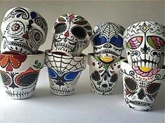 Sugar skull decorated clay pots