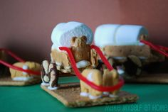Covered wagon snack made of animal crackers, cookies and marshmallows. Cute for Pioneer days.