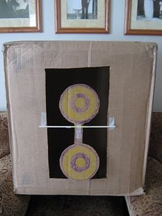 Almost Unschoolers: Cardboard Box Nerf Target that moves when hit