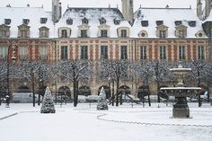 Place des Vosges in the snow- some say Place de Vosges is the most people area of Paris...