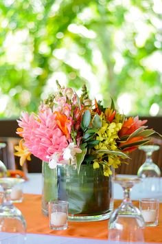 Photos Of Gorgeous Beach Wedding Centerpieces Made With Fresh Exotic And Tropical Flowers Or Elements Like Starfish Shells Sand