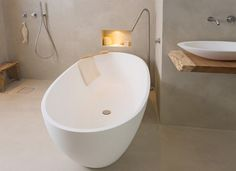 Freestanding bath tub COCOON Atlantis is hand made of matte solid surface material The moderate dimensions make it possible to even transform a smaller bathroom into a luxury personal wellness retreat Dimensions: 1700 x 780 x 530 mm.