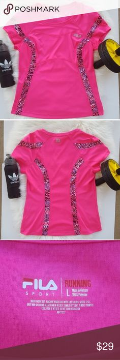 FILA Pink Black Animal Print Workout Running Shirt FILA Pink Black Animal Print Workout Running Shirt Like new condition.  100% polyester. Shirt wicks your moisture keeping you dry when you sweat. Very similar to a Nike Dri-fit shirt.  Has animal print stripes. Stretchy fabric.  Perfect sports t-shirt or to lounge in. Workout performance athletic short sleeve running shirt. Fila Tops Tees - Short Sleeve