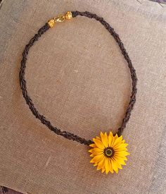 Check out this item in my Etsy shop https://www.etsy.com/listing/235758862/sunflower-necklace-sunflower-jewelry