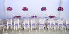 J Morgan Flowers blew me away with these arrangements and table setting!  The floral arrangements include: Blue and purple hydrangeas from Holland , hot pink spray roses, Yves Piaget garden roses, purple Lisianthus, bluebird roses, and magenta phalaenopsis orchids.  So incredibly beautiful!  Love the purple and white damask! Jamilah Photography / via StyleUnveiled.com