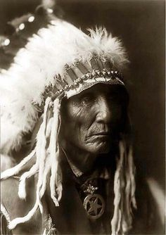 Calico - an Oglala Indian in a Head-and-shoulders Portrait. It was taken in 1890 by Edward S. Curtis