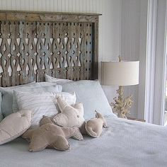 This worn headboard and the beachy accessories (how cute are those pillows?!) really give you a beach house vibe. It's these touches that really develop a particular style in your home! #beachy