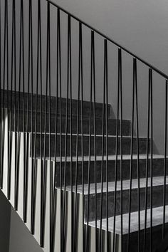 Metal stair rail details. The vertical rods create 'V' forms and are aligned with the bottom of the stringer.