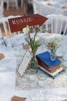 Centre de table #centredetable  #menu #livre #voyage #mariage #deco #pretty…