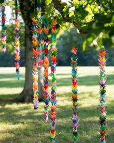 Numerous origami paper cranes, handmade by this groom's mother, were the focal point of cocktail hour. The cranes, which represent prosperity and good luck in Japanese tradition, were strung into garlands and hung from a centuries old linden tree