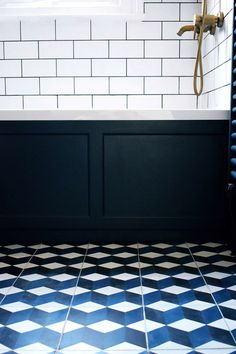 home interior decor ideas for a bohemian vintage spa style bathroom brass fittings geometric cube design cement-tiles-hague-blue-midcentury-teak-vanity-bathroom